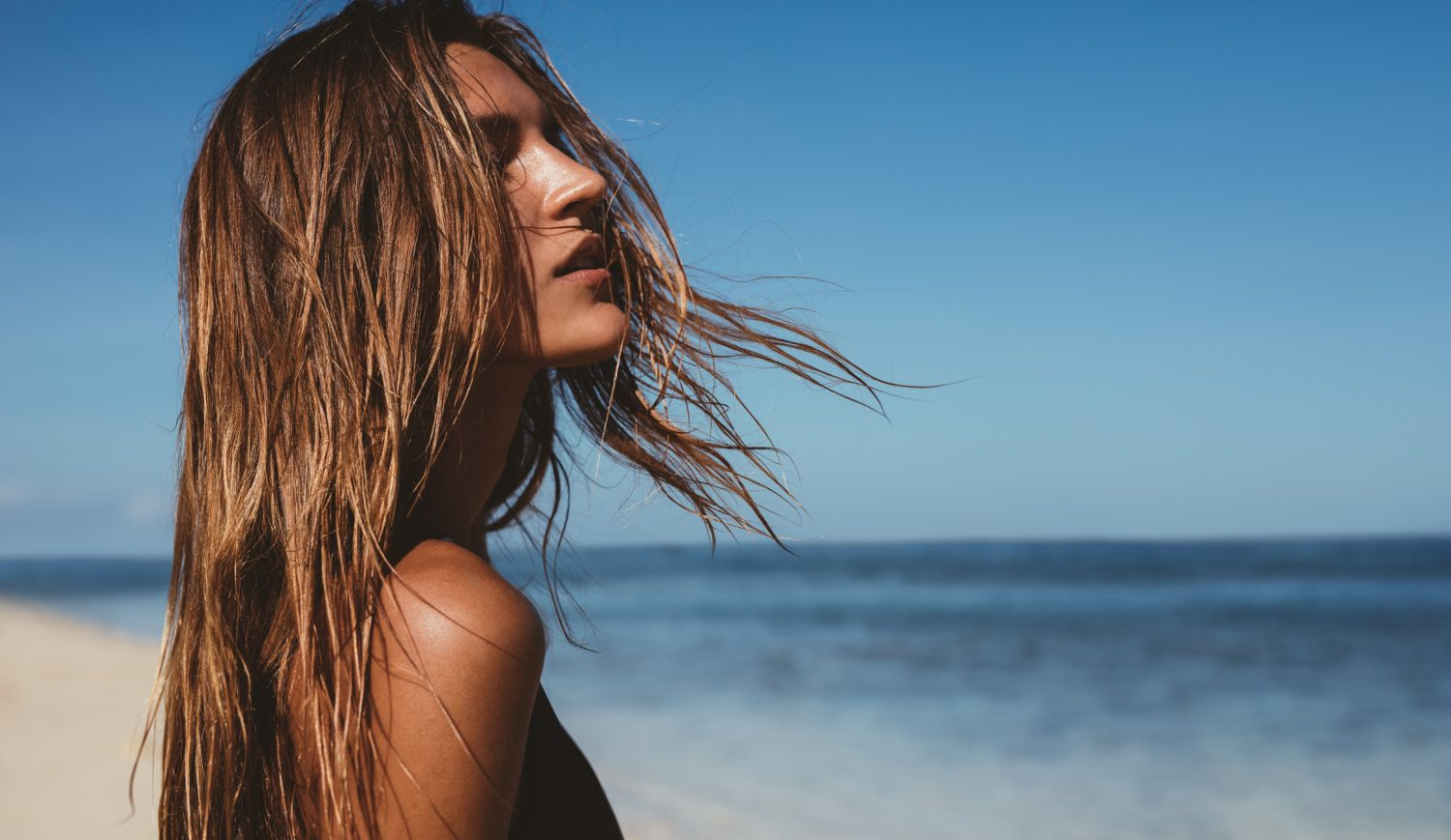eautiful young woman on the beach - things to do Maui