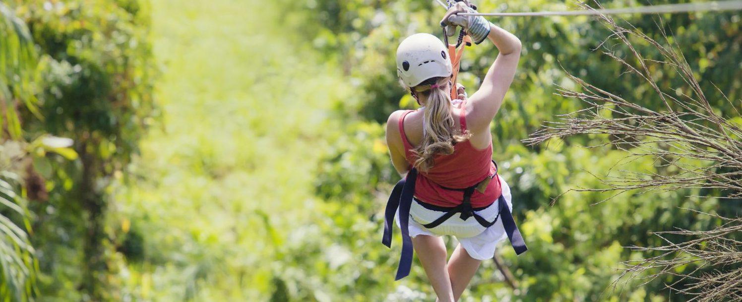 Woman going on a jungle maui zipline adventure