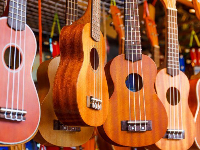 Row of colorful ukulele hanging at the Maui Ukulele Festival