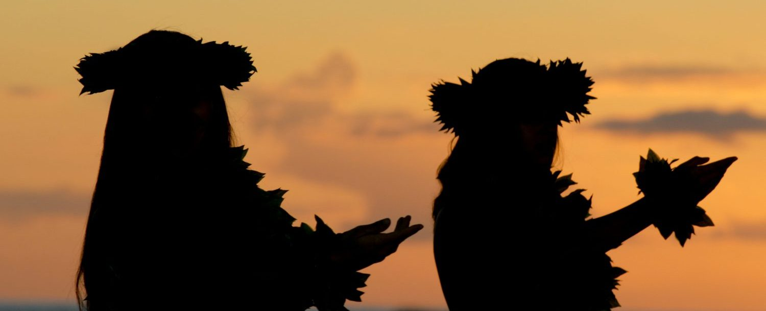 Hawaiian girls dancing the hula at sunset at Te Au Moana Show