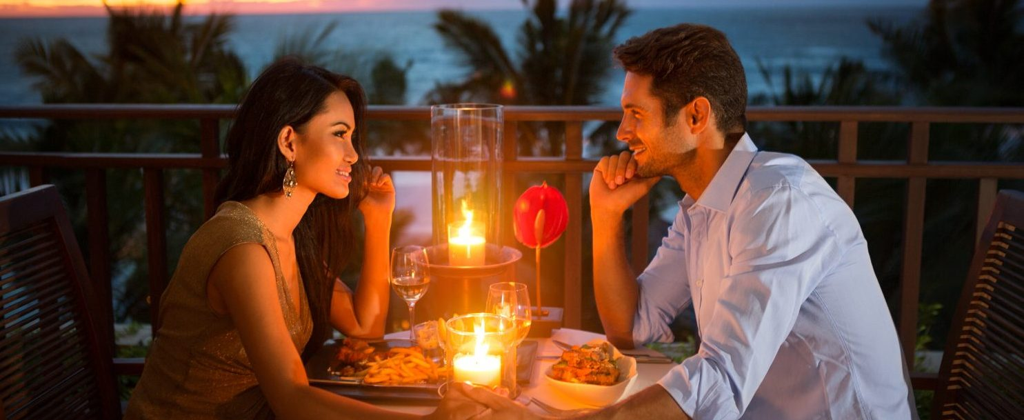 Romantic couple have dinner during their Maui Honeymoon