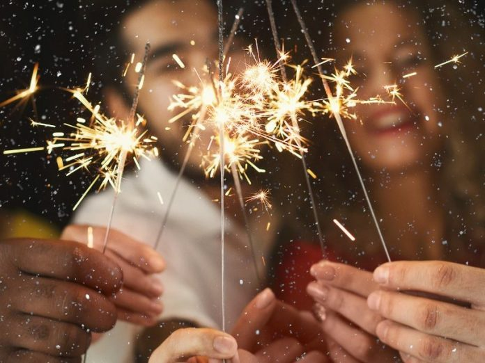 Friends with sparklers for New Years Eve on Maui