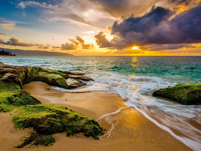Hawaiian island shore at sunset: Oahu or Maui?