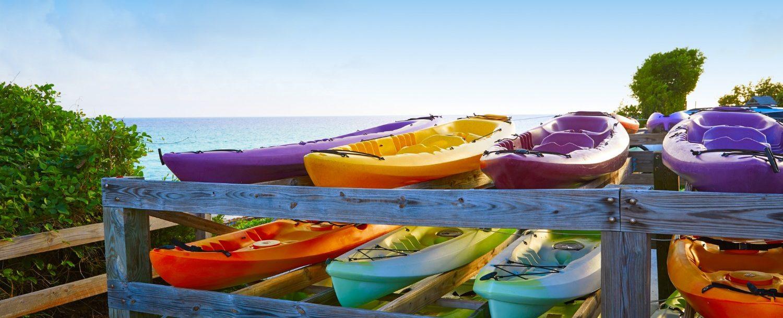 Maui Kayak Adventures | Row of colorful kayaks