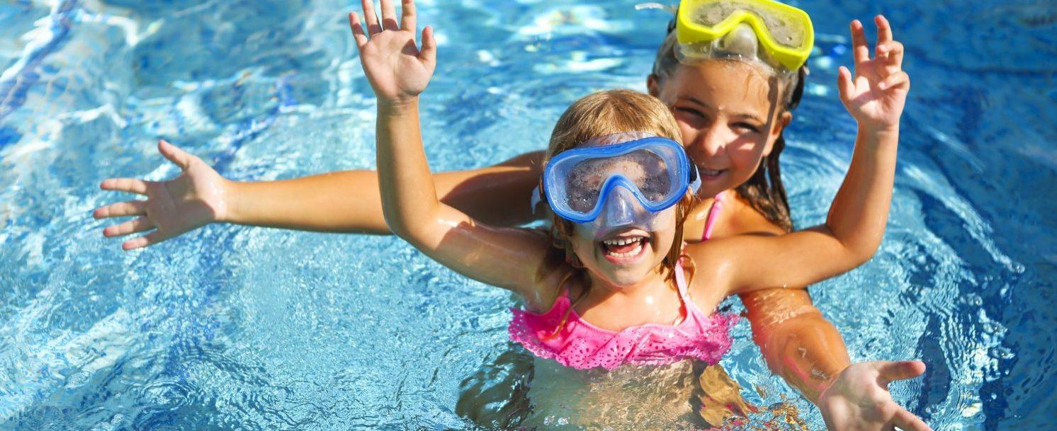 Girls swimming at their Maui Mermaid Adventure
