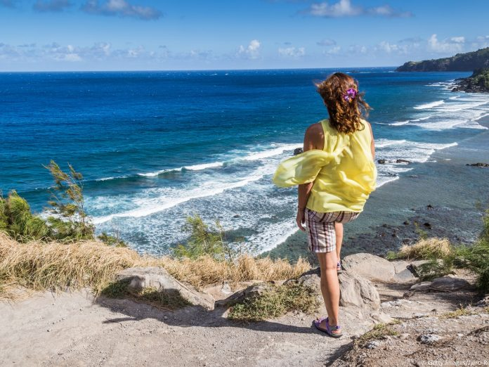 Woman overlooking Maui coast on her 5-Day Maui itinerary