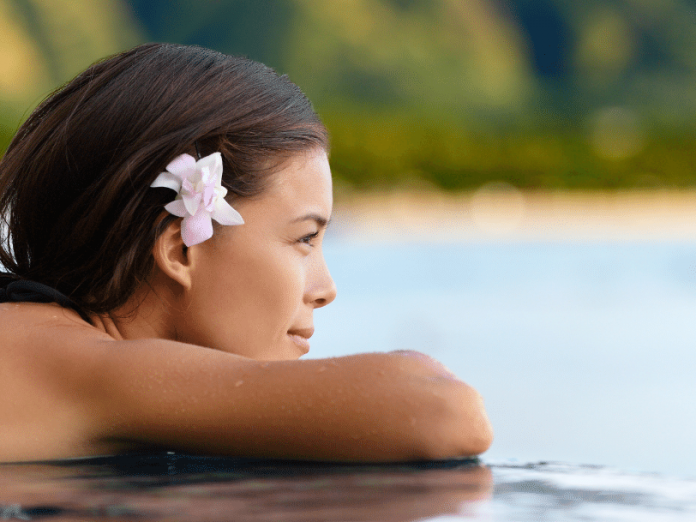 Woman in the pool, one of the best ways to stay cool on Maui this summer